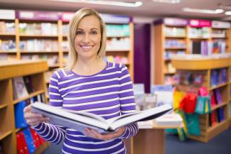 image of a female learner holding a book open